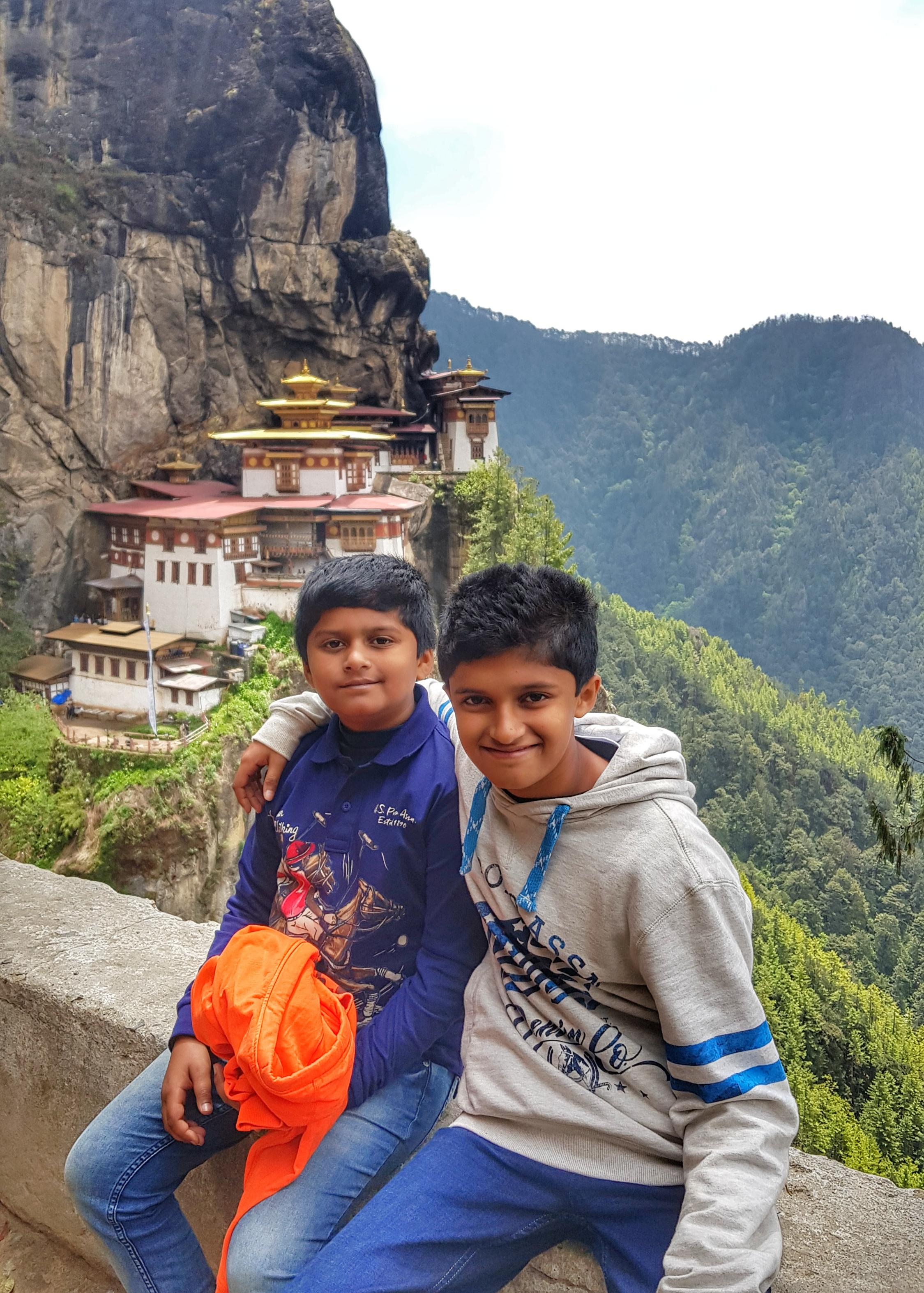 Kids trekking up to Tiger's Nest, Paro, Bhutan